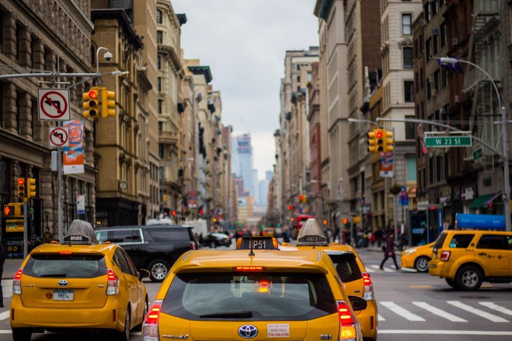 Taxis navigating around Manhattan, New York City. Photo by Ferdinand Stöhr on Unsplash
